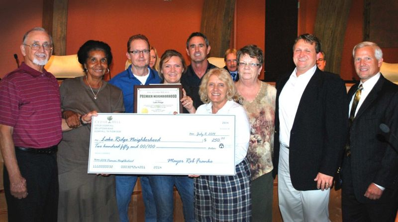 Members of the Cedar Hill City Council and Code Services award Lake Ridge the 2014 Premier Neighborhood.